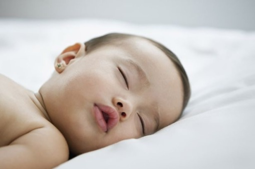 Baby-sleeping-on-bed